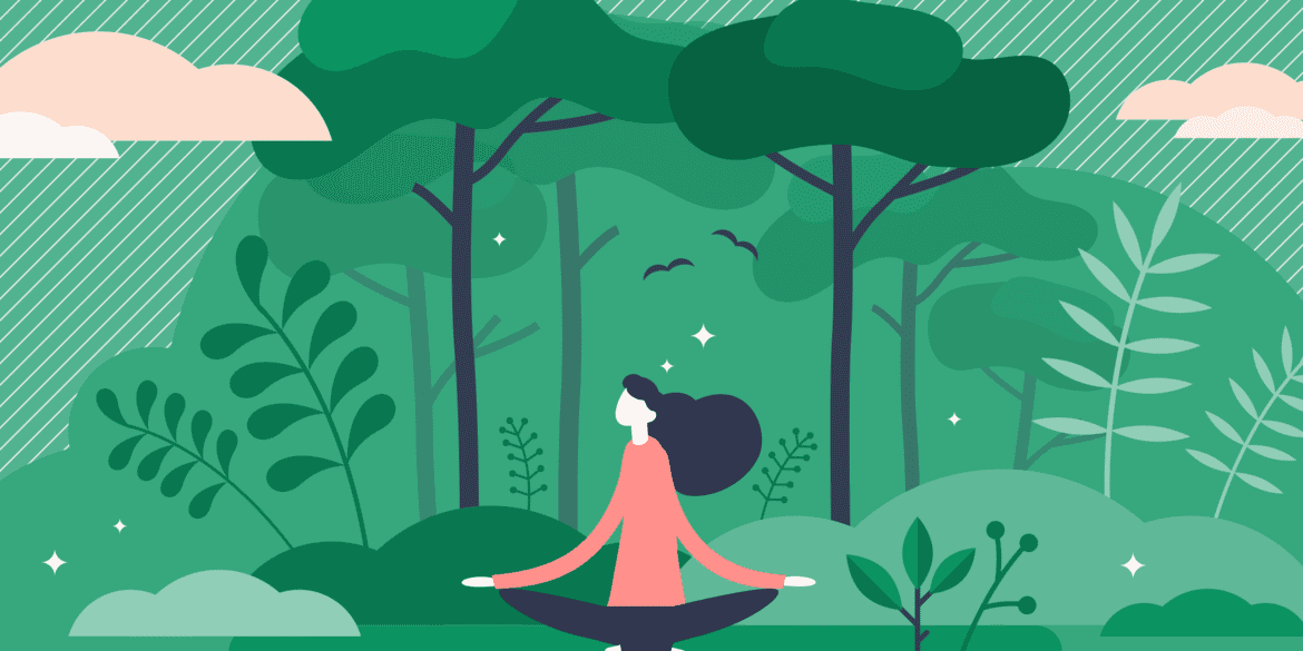 Woman in forest peacefully meditating