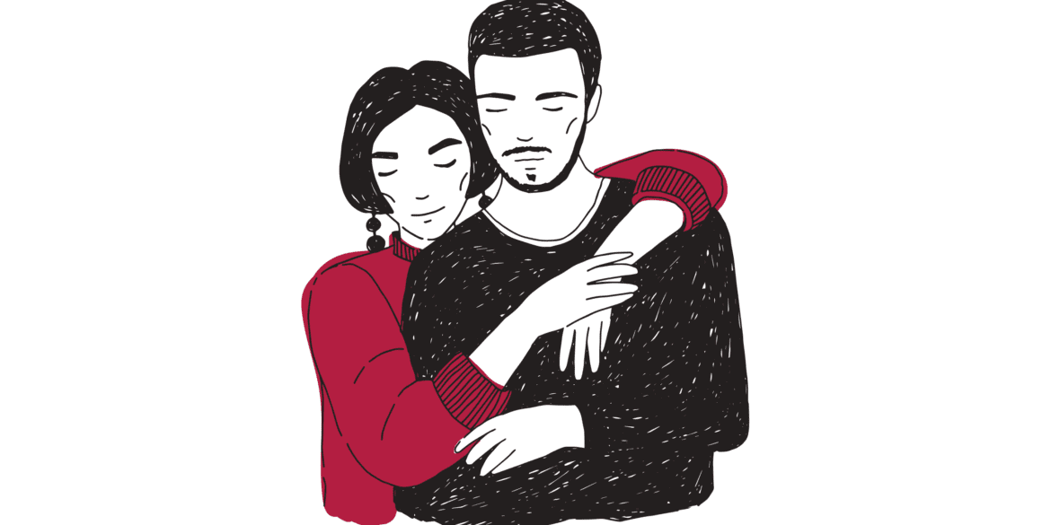 A couple holding each other