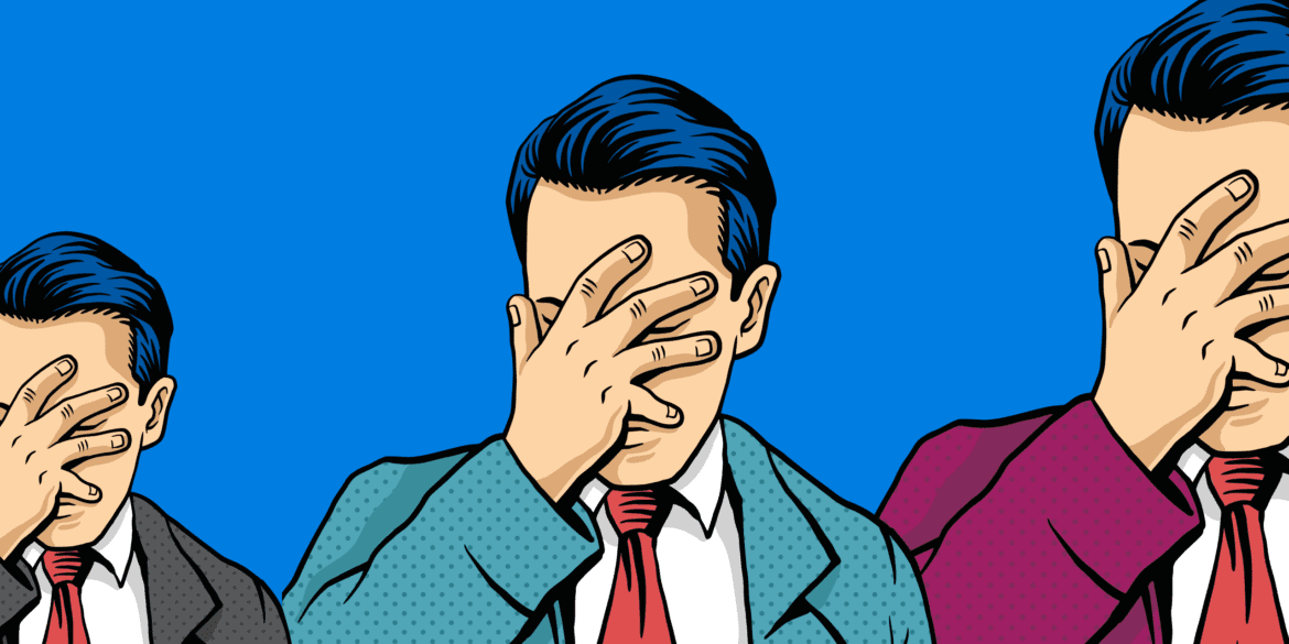 Man in a suite doing a face palm gesture